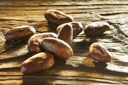 Roasted cocoa beans on wooden board