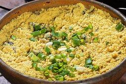 Farofa (toasted manioc flour, Brazil) with spring onions