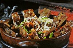 Costela de Porco (grilled pork ribs in a terracotta pot, Brazil)