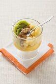 Pineapple, kiwi fruit and walnut starter with cinnamon