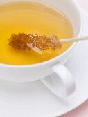 Tea with sugar swizzle stick