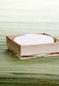 Soft cheese in woodchip box