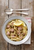 Spaghetti with tuna, capers and lemon and olive sauce