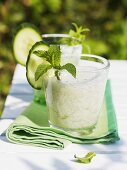 Yoghurt and cucumber drinks with mint on table out of doors