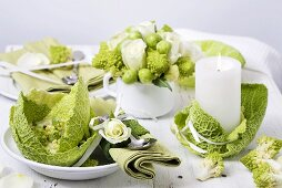 Romanesco soup on laid table with vegetable table decorations