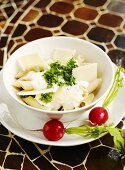 Penne with cheese dressing and Parmesan, radishes