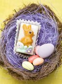 Petit four and sugar eggs in Easter nest