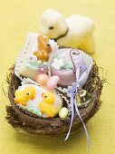 Petit fours and sugar eggs in an Easter nest