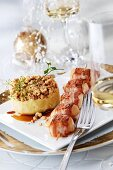 Fried bacon-wrapped scallop skewer with mashed potato