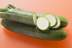 Courgettes on orange background