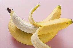 Three bananas on pink background