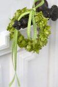 Small hop wreath on a door handle