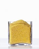Millet in a square glass