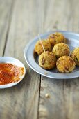 Deep-fried millet balls with tomato sauce