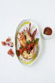Grilled lobster with tomato and basil sauce