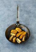 Caramelised exotic fruit in an iron frying pan