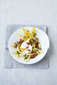 Poached egg on dandelion salad with croutons
