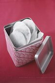 Round tea bags in a tea caddy