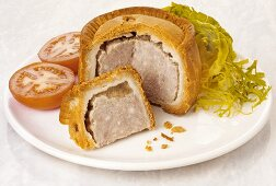 Pork pie with salad (England)