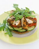 Pesto chicken, cucumber and rocket on wholemeal bagel