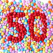 Coloured chocolate beans with the number '50'