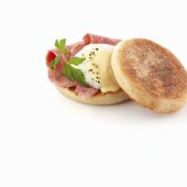 Ham and poached egg in English muffin