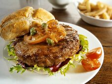 Burger with onion relish and capers