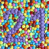 Coloured Smarties showing the number '21'