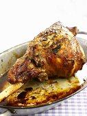 Roast leg of lamb in a roasting dish