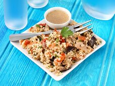 Couscous salad with fried vegetables and vinaigrette