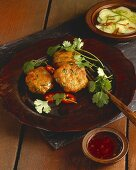 Tod Mun Pla (Thai fish cakes) with a cucumber salad