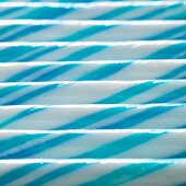 Blue and white striped sticks of rock (full-frame)