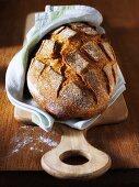 Crusty bread on a kitchen towel