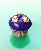 Muffin with purple icing