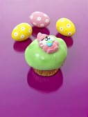 Muffin with green icing and jelly Easter Bunny for Easter