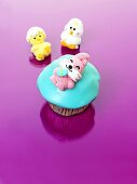 A muffin with turquoise icing and a jelly Easter Bunny for Easter
