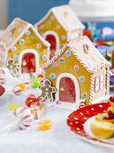 Gingerbread houses with candy canes and sweets