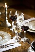 Glasses of different wines on rustic wooden table