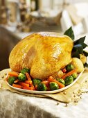 Roast turkey with carrots and Brussels sprouts for Christmas