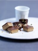 Chocolate and caramel squares and chocolate & pistachio cubes