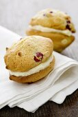 Cranberry whoopie pies, filled with white chocolate cream on a napkin