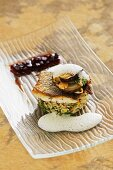 Fried bass on porcini mushroom risotto with beetroot jelly