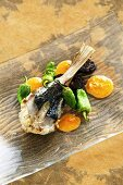 Monk fish with black pudding and sauteed vegetables