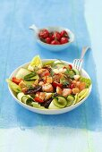 Cos lettuce with salmon, courgette, cherry peppers and croutons