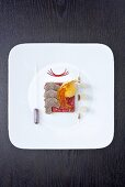 Marinated veal fillet with baked egg yolk and truffles