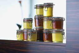 Assorted stocks and soups in preserving jars