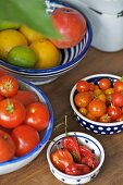 Fruit and vegetables in bowls on a table