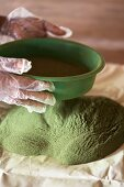 Stevia powder being sieved