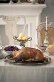 Roast goose with potato dumplings and red cabbage