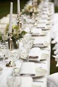 A white wedding breakfast table